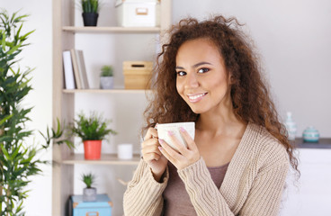 Portrait of beautiful African American girl with coffee