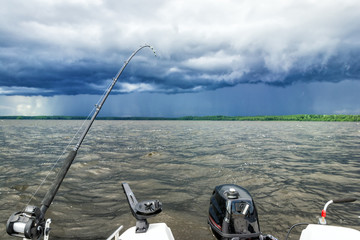 Lake fishing in stormy weather