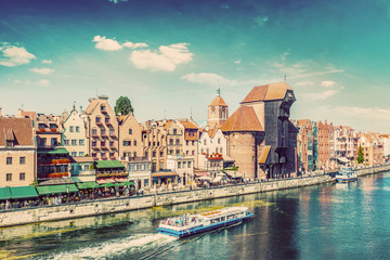 Gdansk old town and famous crane, Polish Zuraw. Motlawa river in Poland. Vintage
