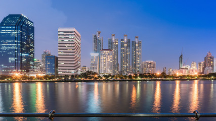 Cityscape at Benchakitti park , green lung of Bangkok , in the evening , Thailand