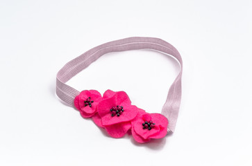 Elastic headband for a baby.