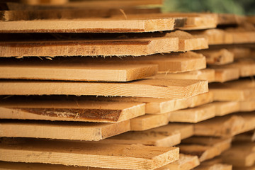 Sstacks of wooden timber planks for texture and background.Timberwork, lumber work and woodwork industry concept. Furniture materials.