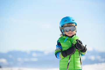 Portrait of a smiling skier boy on a sunny day
