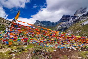 Prayer flags at the mountain in Yading, China.