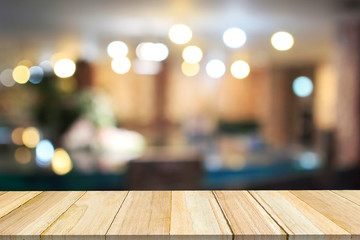 Perspective wood and blurred cafe with bokeh light background.