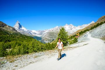 Matterhorn - Hiker in beautiful landscape of Zermatt, Switzerland