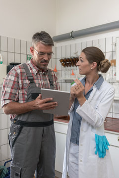 Man and woman working as a team in laboratory of sewage treatment plant
