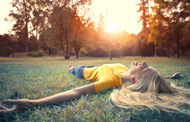 Lying in a green meadow