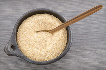 Amaranth seeds in wooden spoon