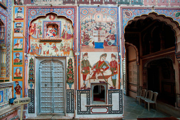 Murals in courtyard of old mansion in Rajasthan,  India