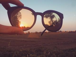 occhiali tramonto paesaggio