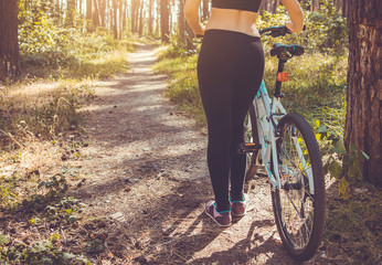 Woman riding a bicycle in the forest