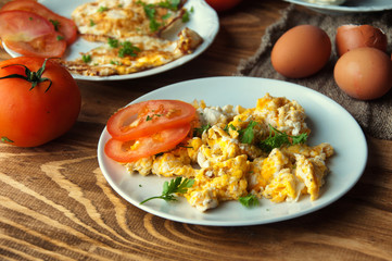 Scrambled, fried, boiled eggs on a wooden table