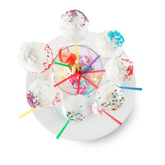 pop candies on white plate isolated on the white background