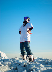 guy in snowboard gear standing on a mountain