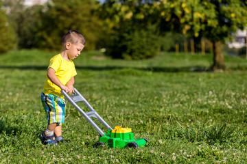 child mowing grass
