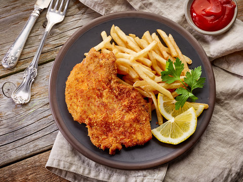schnitzel and fried potatoes