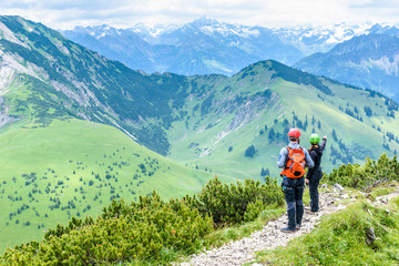 Hiker in beautiful landscape of Alps in Germany - Hiking in the