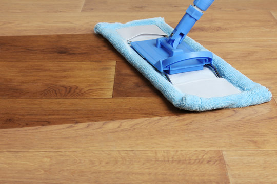 Wash the floor mop. The concept of cleaning.