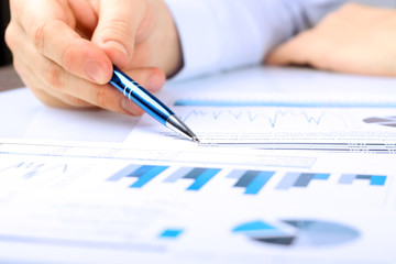 Close-up Of Businessman Analyzing Graph in the office