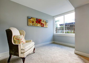 Rest area in the bedroom in blue tones with king armchair.