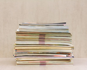 a large stack of magazines close-up, front view