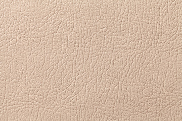 Beige leather texture background with pattern, closeup.