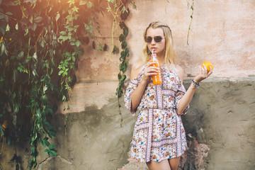 Hippie Girl drinking orange juice