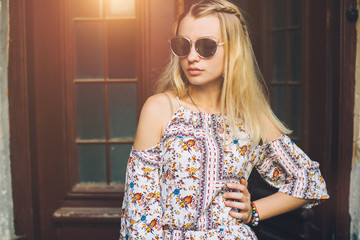 Stylish hippie girl walking down the street and enjoying life.