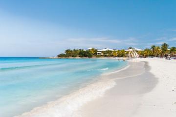 Tourists relax on Varadero sandy beach. Cuba.