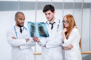 Healthy lungs and the dangers of smoking. Three confident doctor