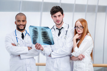 Successful doctors smiling looking at the camera. Healthy lungs
