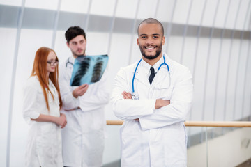 Portrait of a successful doctor Three confident doctor examining