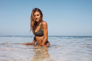 Beautiful woman sitting in sea water
