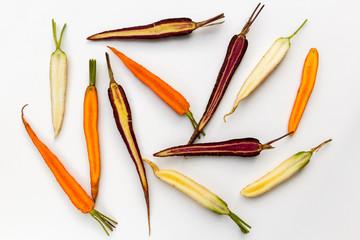 Organic heirloom carrot varieties of purple,  orange and white carrots