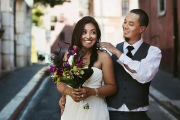 Happy stylish smiling asian couple