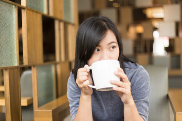 Woman drinking coffee in the morning at cafe