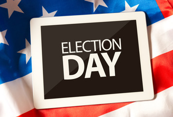 Election Day on tablet and the US flag