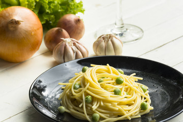 Spaghetti or pasta and ingredient on white table.Close up