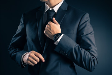 Businessman Dressing Up a Black Suit