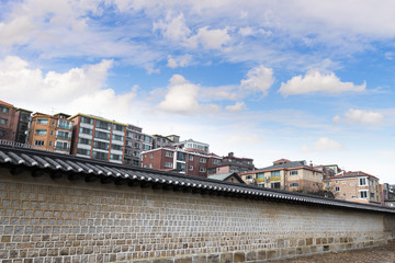Architectural detail - Korean Tradition stone wall and colorful