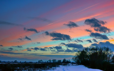 Winter Landscape With Pink Clouds At Sunset