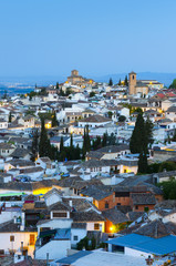 Spain, Andalucia, Granada Province, Granada, Sacromonte and Albaicin Districts, centre is Iglesia de San Cristobal (Church of St. Christopher) and right Iglesia de San Bartolome (Church of Bartholomew)