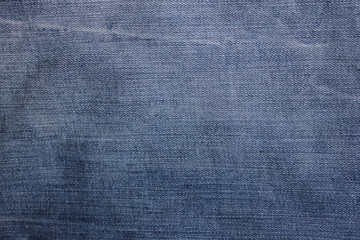 Jeans texture dark blue and white denim natural pattern fabric clothes background with diagonal lines and stitches