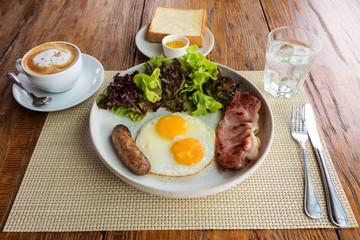 American breakfast on wooden table