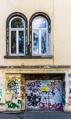 Graffiti on a houses front and garage - City Lifestyle