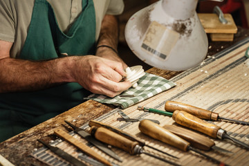 Musical instrument maker working on neck of violin