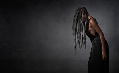 african girl hiding face with hair