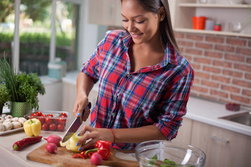 young asian woman  chopping  vegetables for detox in kitchen