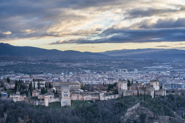 Panorama of Alhambra palace and fortress complex at dusk in Granada. Andalusia. Spain